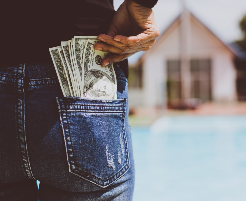 Woman with dollars money in her pocket.